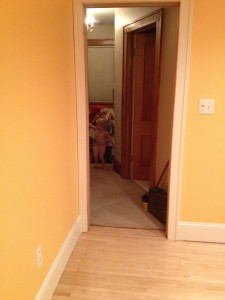 Notice the partially-clad Isla approaching her improved room for the first time.
